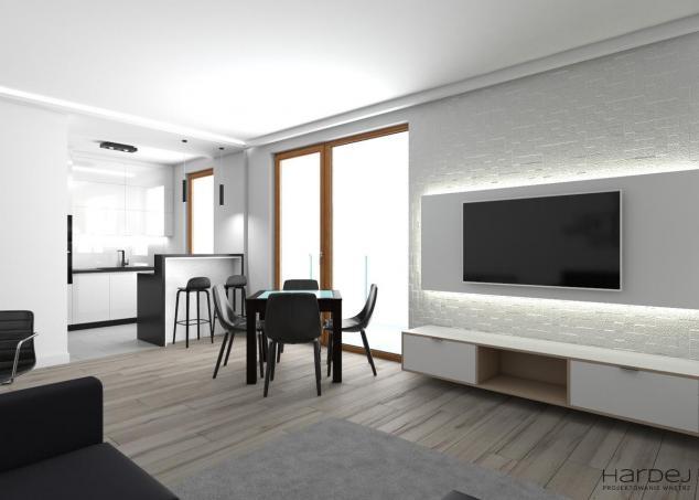 kuchnia otwarta na salon styl minimalistyczny