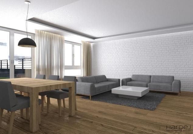 salon cegła białe ściany jasna podłoga aranżacja
